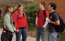 four students talking